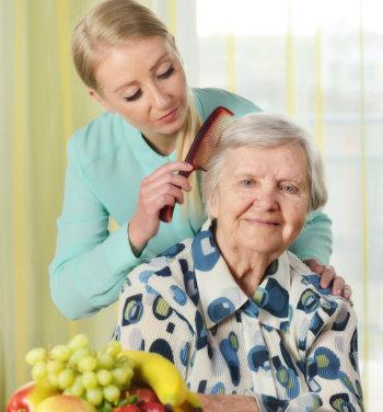 Caregiving Combing patient's hair